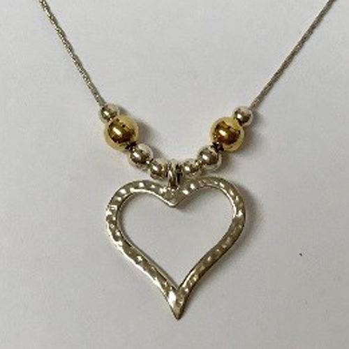 Sterling silver heart pendant on a silver chain with silver- and gold-plated balls