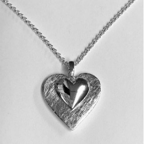 Sterling silver solid double heart pendant on a silver chain