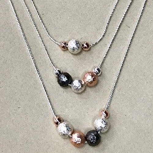 Three strand costume necklaces with a mixture of silver, rose gold and pewter balls