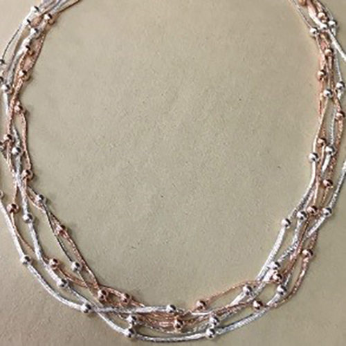 18-inch multi strand silver and rose gold coloured costume necklace