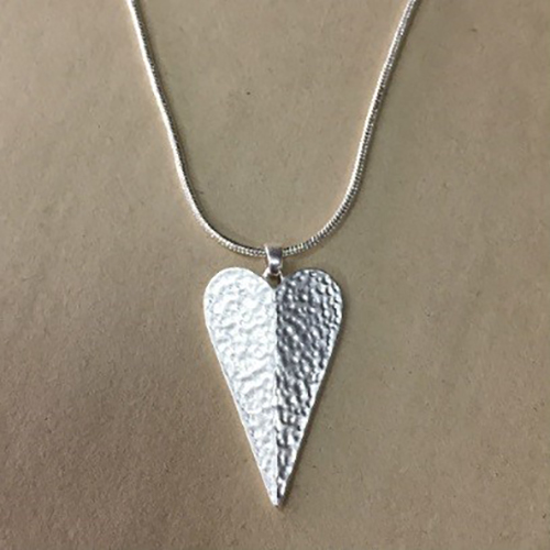 18-inch silver coloured costume necklace with elongated hammered effect heart pendant