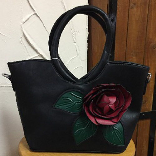 33cm x 21cm small black bag with red flower detail on front