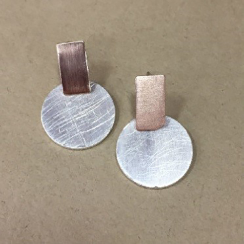 Costume drop round disc earrings in a silver and rose gold colour with satin and scratched effect