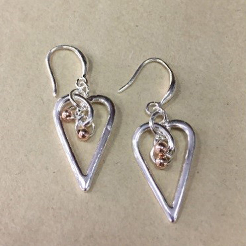 Costume heart drop earrings in a silver colour with small rose gold coloured ball charms