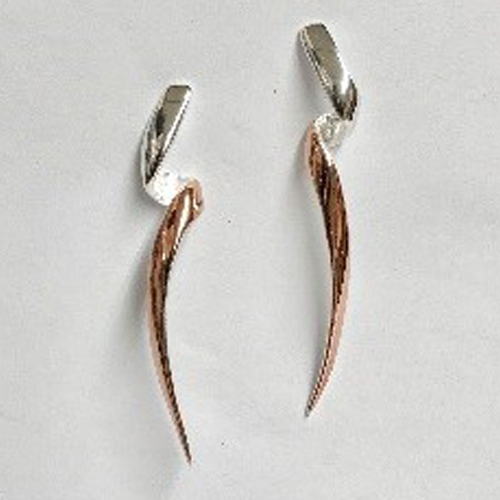 Long twist sterling silver earrings with rose gold-plated detail