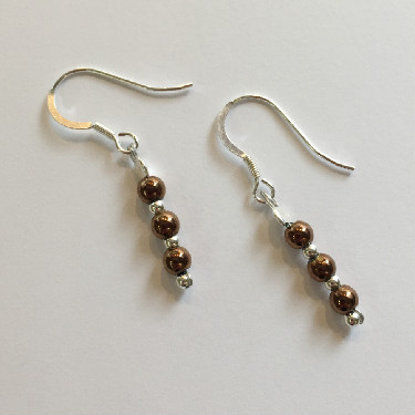 Silver and bronze coloured earrings