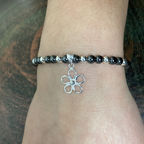 Silver and Haematite Bracelet with open flower charm
