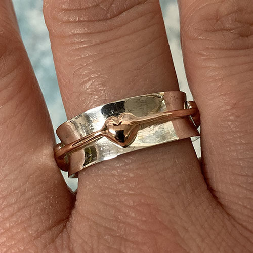 Silver ring with rose gold hearts