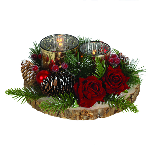 Festive candle holders on wooden base