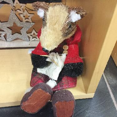 Festive sitting badger