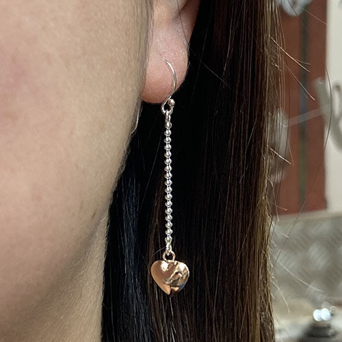 Sterling silver earrings with rose gold drop heart