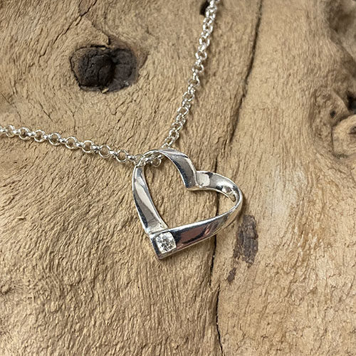 Sterling silver open heart pendant with cubic zirconia stone