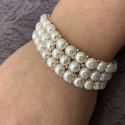 Sterling silver and pearl stretch three strand bracelet
