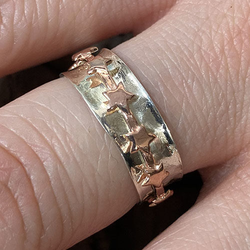 Sterling silver ring with rose gold spinning stars