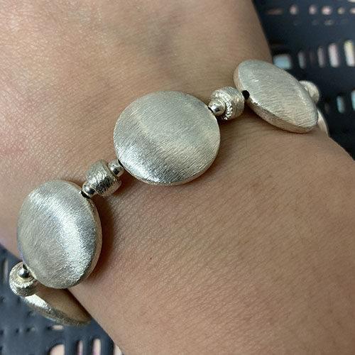 Solid silver disc bracelet