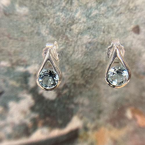 Sterling silver stud earrings with blue topaz