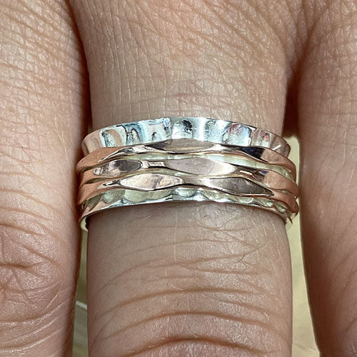 Sterling silver and rose gold spinning ring